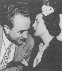 Mary Astor conferring with her attorney—Roland Rich Woolley (Hearst Newspaper Collection, University of Southern California Library)