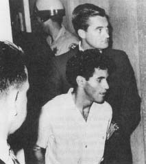 Sirhan Sirhan in custody the day after he shot Senator Robert F. Kennedy. Despite his admission of guilt, a lengthy trial followed. (API Wide World Photos)