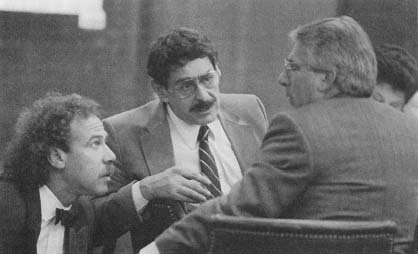 Joel Steinberg conferring with his attorneys. Steinberg was convicted of murdering 6-year-oid Lisa Steinberg whom he had illegally adopted (AP/Wide World Photos)