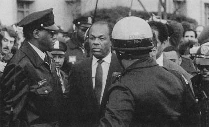 Mayor Marion Barry is escorted by police following his appearance before a federal magistrate. (AP/Wide World Photos)
