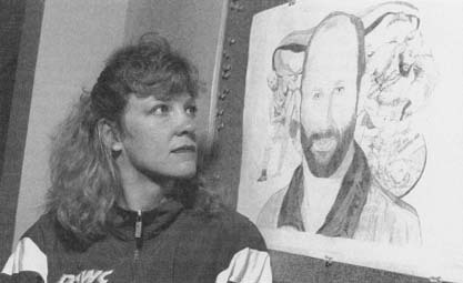 Nancy Schultz looks at drawing of her late husband David, murdered by John E. DuPont. (API Wide World Photos)